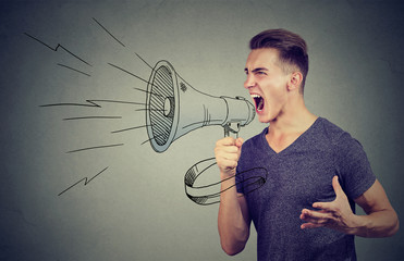 Young man screaming into a megaphone making an announcement