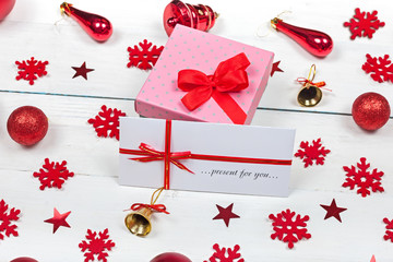 Gift - a box decorated with a bow and an envelope