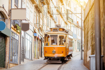 Street view with famous retro tourist tram in the old town of Porto city, Portugal Fototapete