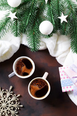 two cups of coffee and fir branches