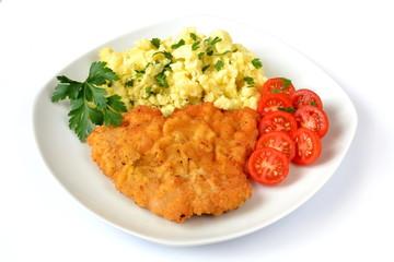 kotlet schabowy z ziemniakami i pomidorem