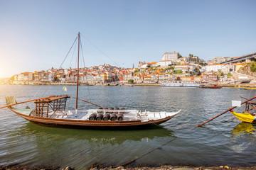 Landscape view on the Douro river with boat in Porto city, Portugal