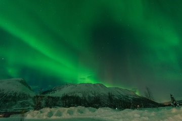 Northern lights over snowy mountain in winter of 2014,Tromso,Norway
