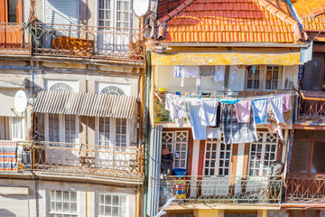 Street view on the beautiful old buildings with portuguese tiles on the facades in Porto city, Portugal