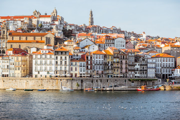 Landscape view on the old town on the riverside of Douro river in Porto during the sunset in Portugal