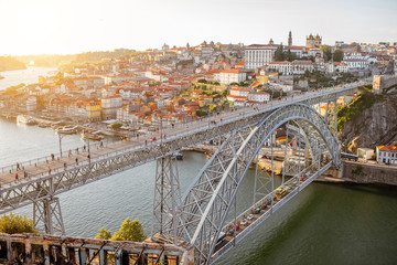 Landscape aerial view on the Luis bridge on the Douro river in Porto city during the sunset in Portugal