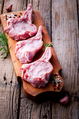 Raw fresh meat Veal rib Steak on bone  on a wooden vintage background with spices and rosemary