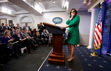 White House Press Secretary Sarah Huckabee Sanders coughs as she holds the daily briefing at the White House in Washington, DC