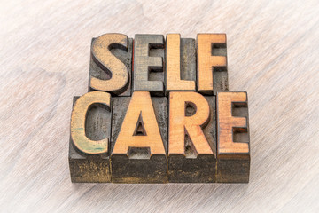 self-care word abstract in wood type