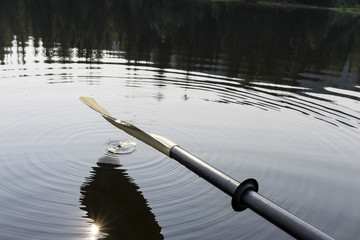 An oar hanging over lake