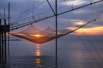 Fishing net on the beach at dawn, Sottomarina, Chioggia, venetian lagoon, Italy
