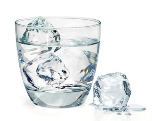 Glass of water with ice on white backgrond