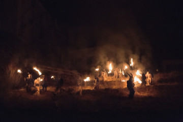 The Krampus come out of the wood during the traditional festival, Tarvisio, Julian Alps, Italy