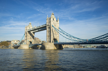 Scenic landscape view of Tower Bridge standing tall in afternoon light above the River Thames as viewd from the South Bank in London, England