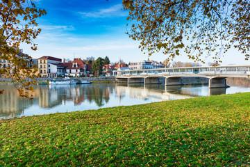 Bridge to spa island in Piestany, Vah river, riverbank, blue sky (Slovakia)