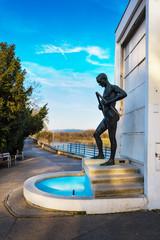 PIESTANY, SLOVAKIA – NOVEMBER 7 2017: Fountain with statue of Crutch–breaker near bridge to spa island in Piestany