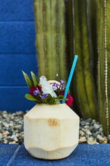 Close-up of coconut drink with flowers