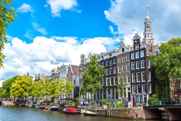 Photo sur Toile Amsterdam Amsterdam canals and boats, Holland, Netherlands.