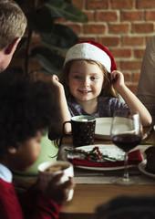 Cheerful caucasian girl wearing a Santa hat