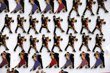Refrigerator magnets with the image of tango dancers are sold during the festival of tango on the street