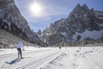 Ski cross country in the winter landscape of Tre Cime di Lavaredo Natural Park, Sesto, dolomites, italy
