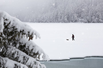 Walk under the snow on Lake Anterselva, Pusteria Valley, dolomites, Italy