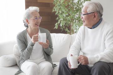 An old couple enjoying friendship tea time