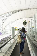 Traveler thai women use smartphone take photo with ticket and passport in Suvarnabhumi International Airport