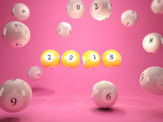 2018 New Year sign on lottery balls over pink background