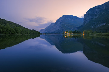 The Toblino Castle reflects on the waters of the homonymous lake at twilight, Valley of Lakes, Valle dei Laghi, Trentino, Italy