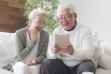 An old couple enjoying tablets