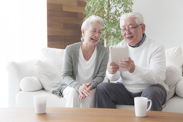 An old couple enjoying tablets Wall mural