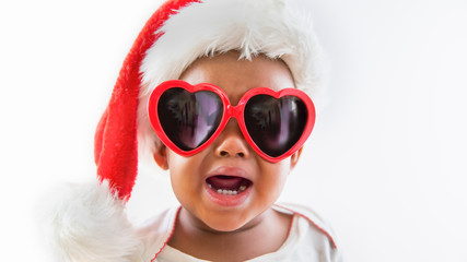Funny portrait of naughty African American Baby wearing Sunglasses and Santa Hat Screaming Crying