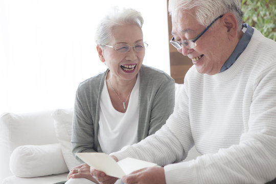 An old man who seems to be happy to receive a letter from his wife