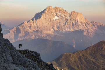 Man photographing Mount Civetta, at sunset, Dolomites, Italy