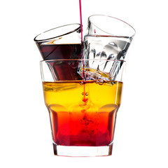classic alcoholic cocktail with shots, vodka and liquor isolated on white background. Barman pouring syrop