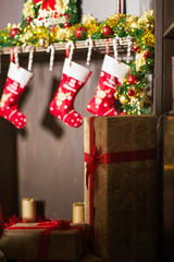 Details, objects of a beautiful Christmas interior. Hall, living room, office with a large leather chair, a bookcase with a fireplace. New Year's room with a wreath, a garland, gifts. Place for text