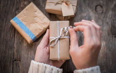 Woman opening and presenting gift box