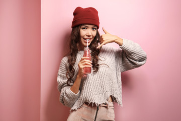 Beautiful hipster girl on pink background
