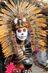 The dancer performing traditional Aztec dances in the capital city of Mexico