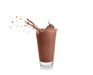 Glass with splashing cocoa, isolated on white