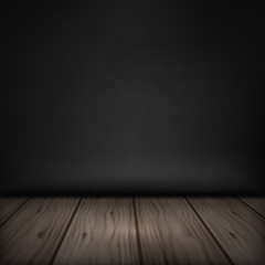 Wooden dark floor with black wall