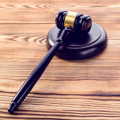 Judges gavel and sound block on wooden background. Concept of rule of law and justice, toned image