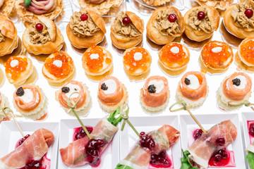 Gourmet appetizers: caviar, venison, tuna and salmon.