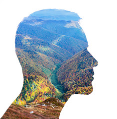 Creative double exposure of a man and autumn forest.