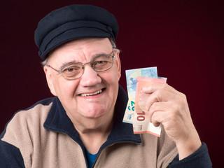 portrait homme billets de banque en main