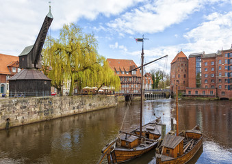 Historic harbor of Luneburg with old crane and ships