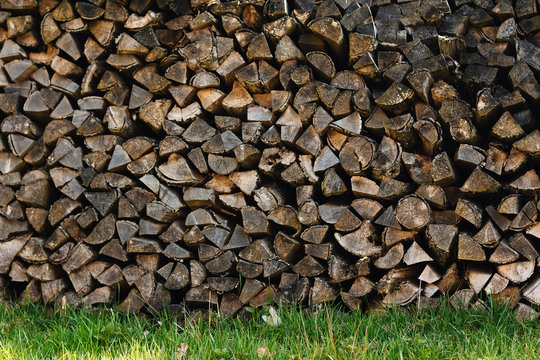 ends of logs wooden background. toning. wood in the stack.