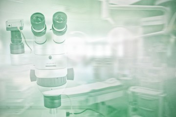 Composite image of microscope in laboratory