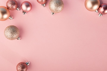 Pink baubles on pink background Fototapete